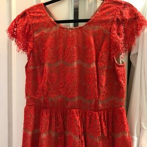 Coral lace peplum top